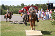 Three mounted officers performing an obstacle course