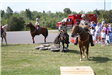 Mounted officers doing obstacle course with onlookers