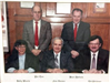 Group photograph of five commissioners on 1980s and 1990s
