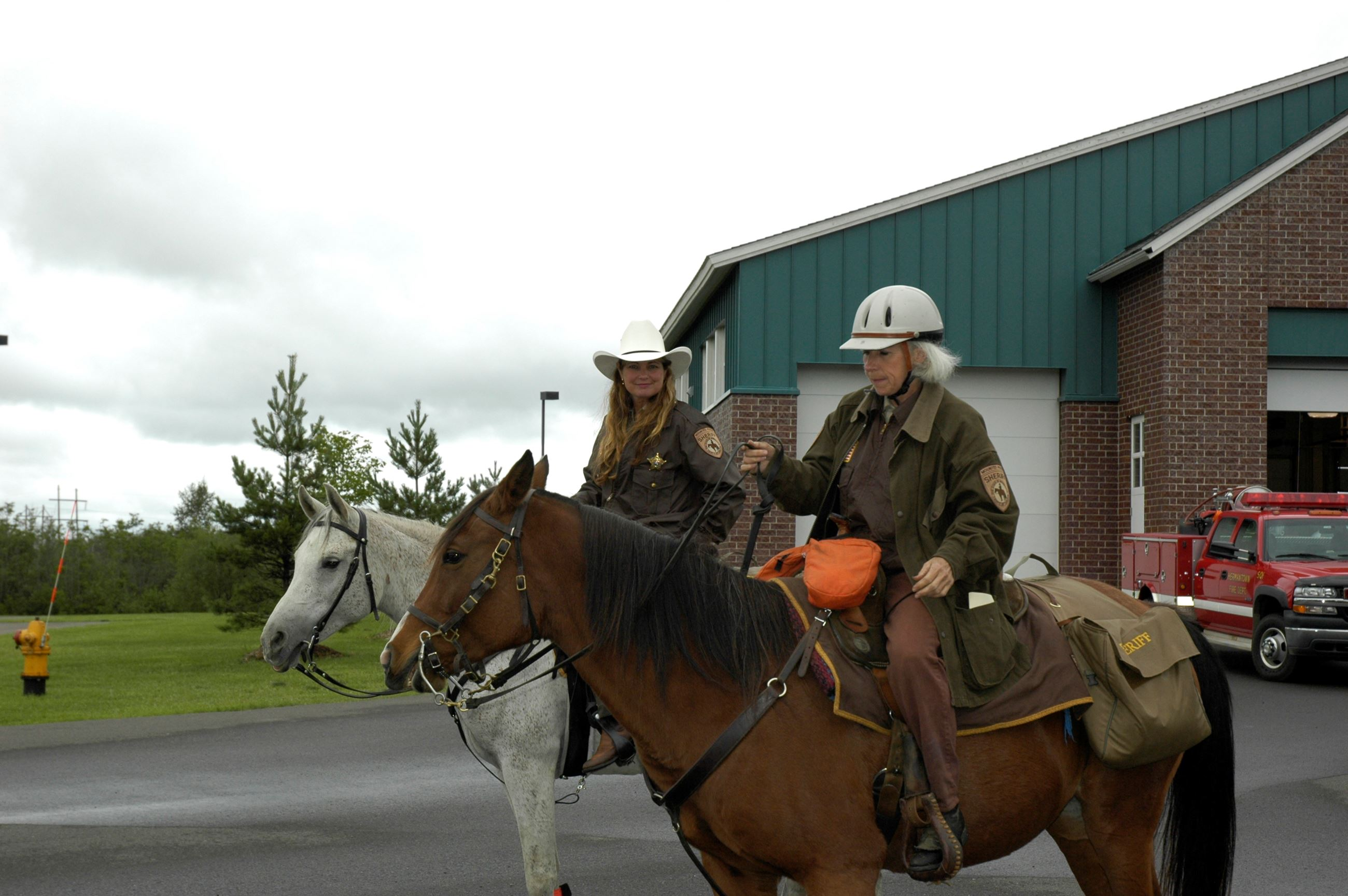 Two officers riding horses