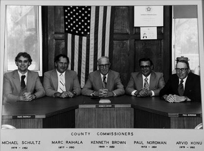 Black and white image of commissioners from 1970s to 1980s